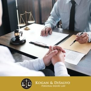 attorney with client discussing compensation for car accident
