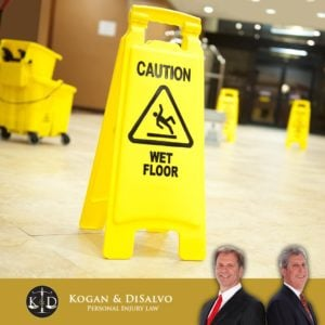 caution wet floor sign in store with attorney for florida slip and fall